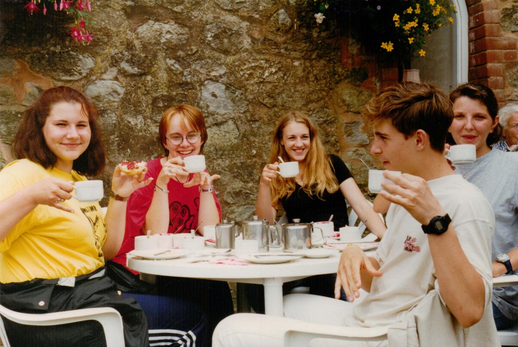 a group of international friends enjoying an English Cream tea