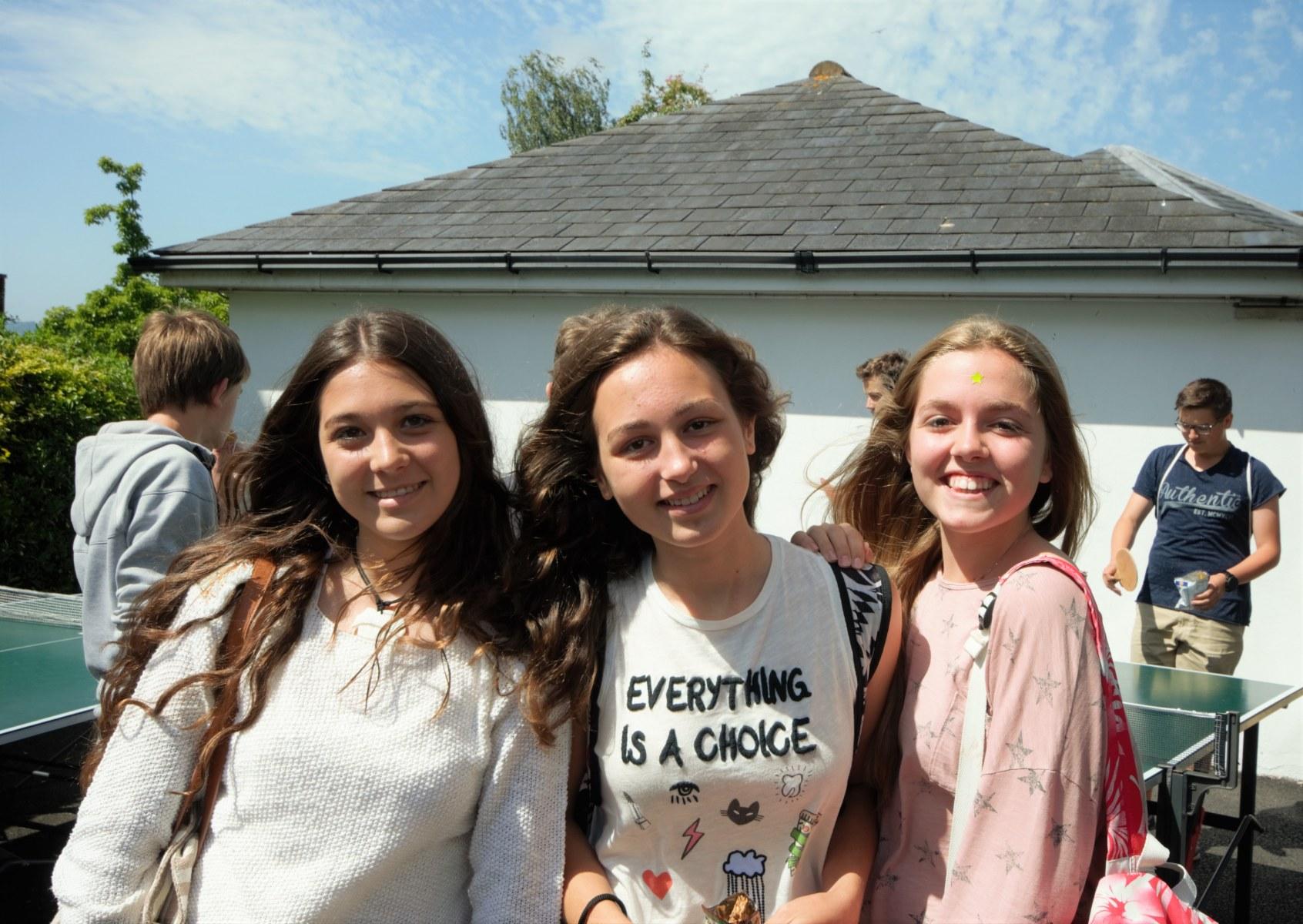 Close up of three spanish girls smiling